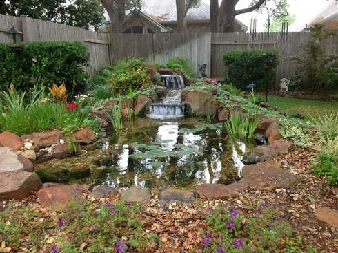 Small 10x12 pond with waterfall in the Austin, TX area starting at $12,000